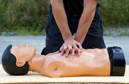 Man giving CPR on a dummy
